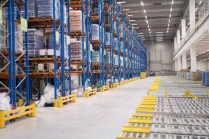 warehouse-storage-interior-with-shelves-loaded-with-goods-min