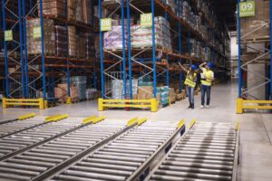 warehouse-workers-checking-inventory-goods-distribution-large-storehouse-min